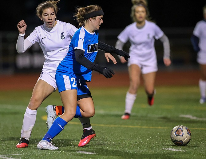 Carson High's Madison Rabideau dribbles past a Damonte Ranch defender Tuesday night. The Mustangs left Carson with a 2-0 win.