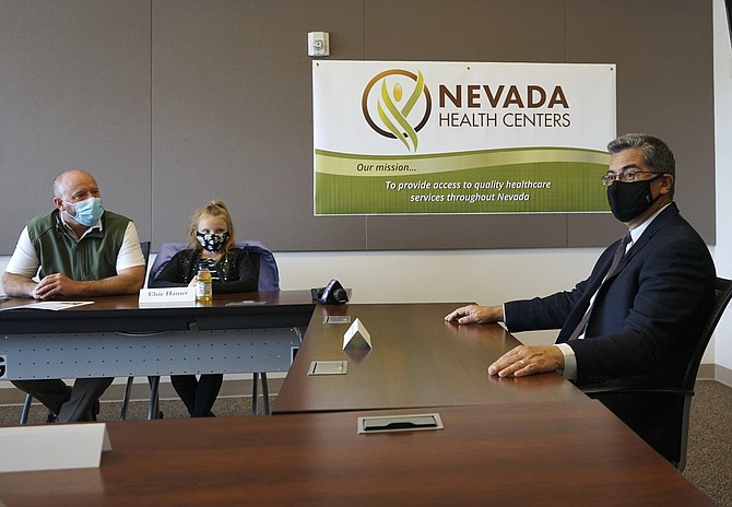 U.S. Health and Human Services Secretary Xavier Becerra sits during a meeting at the Nevada Health Centers in Carson City on Tuesday. (Samuel Metz/AP)