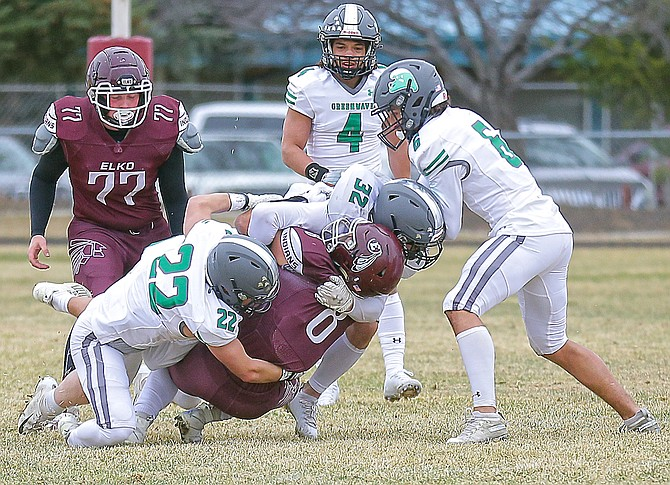 The Greenwave defense shutout Elko 33-0 on Saturday. In on a tackle are Josiah Rosario (22), Xavier Capton (32), Julian Evans (4) and Levi Andrews (6).