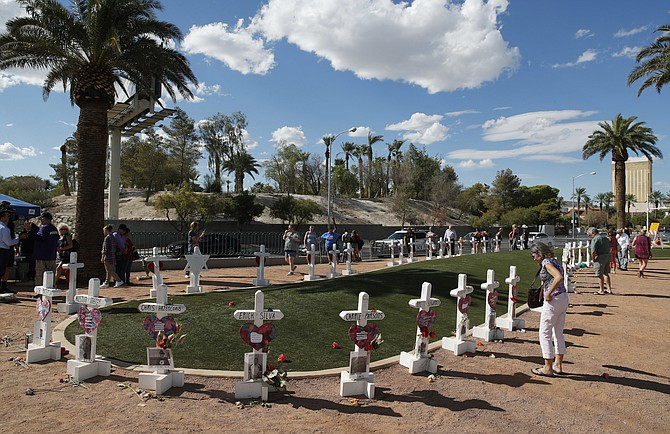 People visit a makeshift memorial for victims of the Oct. 1, 2017, mass shooting in Las Vegas on Sept. 30, 2018. (Photo: John Locher/AP, file)