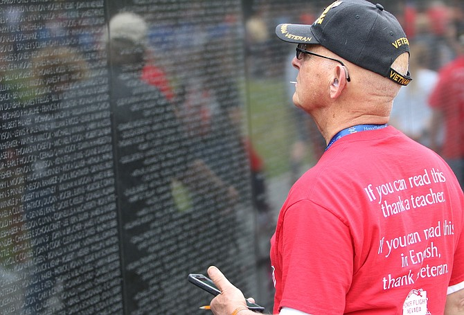 """Former Vietnam War Army veteran and Washoe County District Attorney Richard """"Dick"""" Gammick looks at the names on the Vietnam Veterans Memorial Wall in Washington, D.C. Gammick and other Honor Flight Nevada veterans visited the nation's capital in June 2019. National Vietnam War Veterans Day is Sunday, and a special remembrance day will be conducted at Bartley Ranch Regional Park in Reno and is hosted by the Vietnam Veterans of America, Sierra Nevada Chapter 989. Vietnam wall 2"""