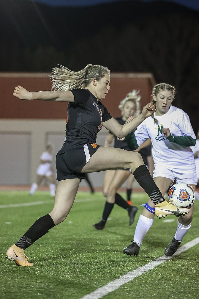 Douglas High freshman Aleeah Weaver takes a touch to settle the ball against Bishop Manogue last week. Weaver scored in Douglas' 2-0 shutout win over Spanish Springs Tuesday night.