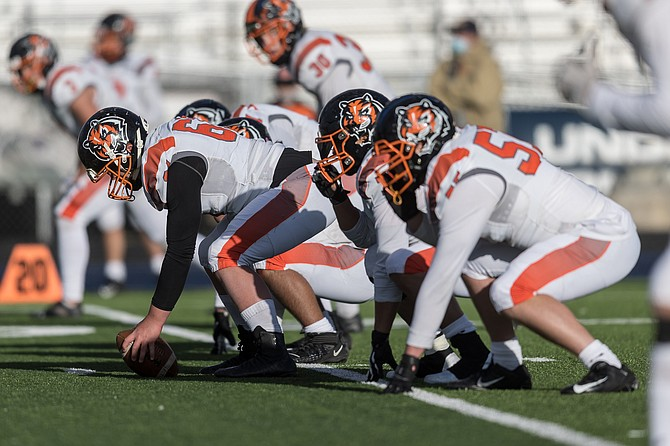 The Douglas High offensive live gets ready to snap the ball against Damonte Ranch last Saturday. The Tiger line is expected to play a monumental role Friday night in Douglas' contest against Reno High.