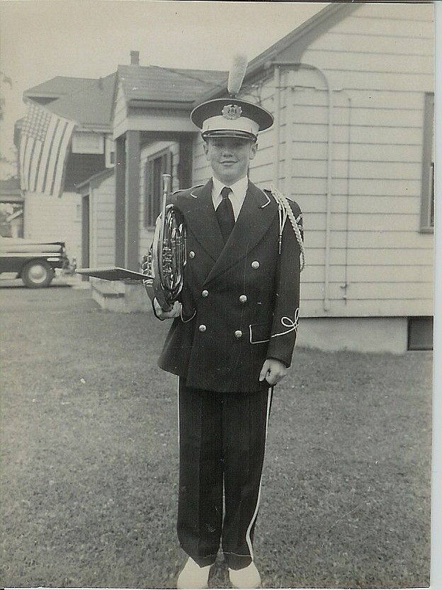 Lynn Public Schools Marching Band French Horn player, Ken Beaton, before the 1953 Memorial Day parade. Where were you in 1953 when cars had fins?