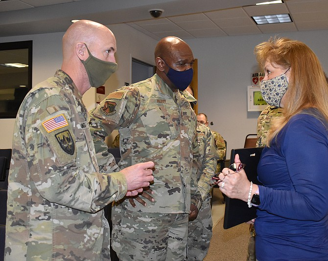 Denise Del Porto, right, a supervisor at International Gaming Technology (IGT), discusses employer support of military service members with Nevada Guard Adjutant General Maj. Gen. Ondra Berry, center, and Command Sgt. Maj. Michael Spaulding on Feb. 12. IGT was among 98 Nevada businesses and organizations to receive a Patriot Award this winter for supporting the Guard.