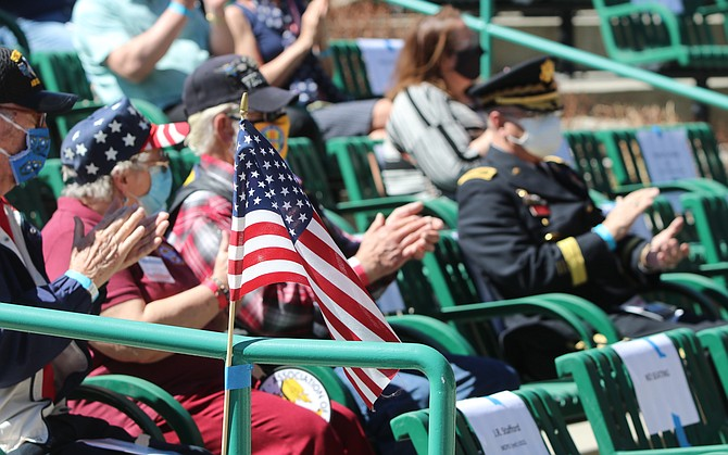 Veterans who attended the National Vietnam War Veterans Day clap after one of the speaker's made a point about sacrifice.