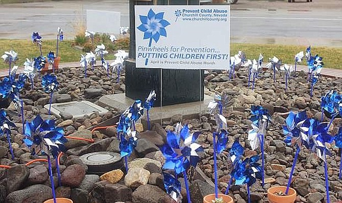 Pinwheels each representing an investigation into child abuse are planted each year in Fallon.