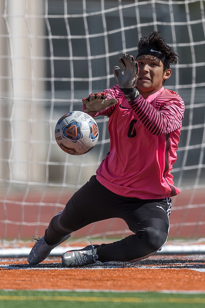 Emilio Munoz makes a diving save in Douglas High's 0-0 draw against South Tahoe Monday.