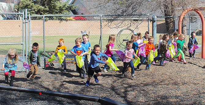 Students at Trinity Lutheran Church Preschool in Gardnerville make the dash Friday to gather Easter eggs hidden around the playground. Empty eggs represent Jesus' empty tomb, according to organizers, something the children have been taught since Lent.