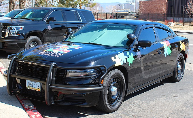 The Douglas County Sheriff's Office's newly wrapped autism patrol car.