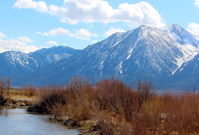 Jobs Peak rises above the East Fork of the Carson River on Monday afternoon.