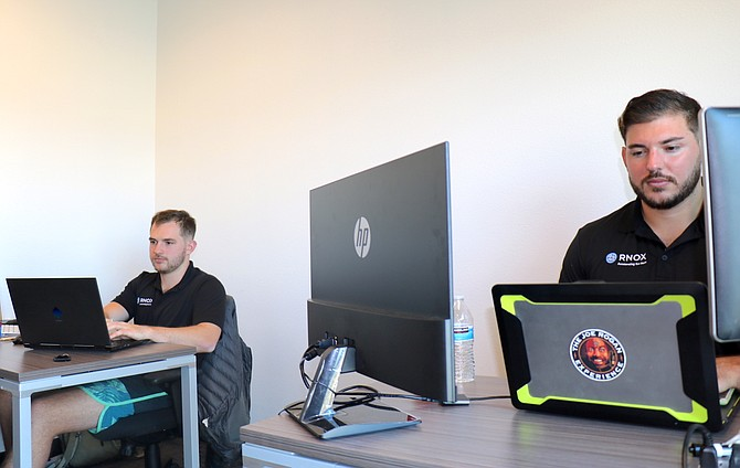 PersonaFi co-founders Kevin Baize, right, and brother Don Baize work inside their office at RNOX, the 1-year-old tech accelerator located at 10615 Professional Circle in South Reno. PersonaFi is one of three companies selected for RNOX's 2021 spring cohort.