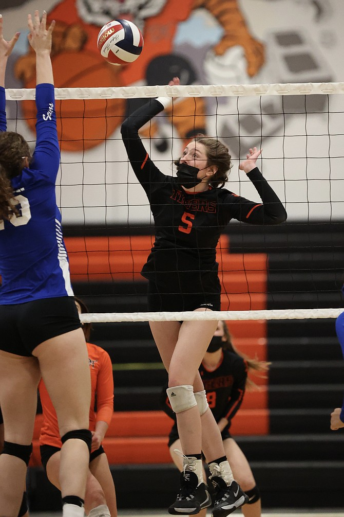 Marin Collins (5) puts away one of her seven kills Monday night in Douglas' regional quarterfinal win over Carson. Douglas volleyball turns around and takes on Reno tonight in the regional semifinal.