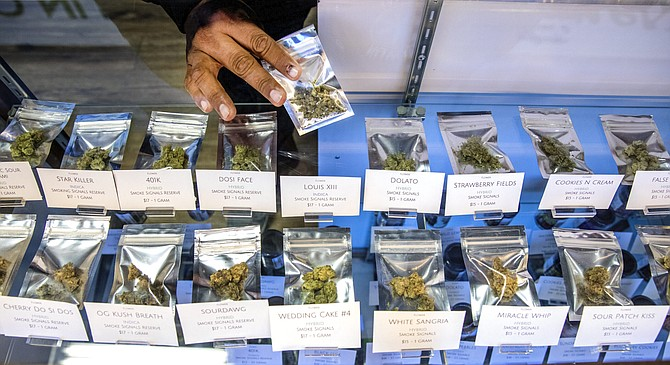 Benny Tso, tribal council member and former chairman of the Las Vegas Paiutes, holds marijuana product at Nuwu Cannabis Marketplace at 1235 Paiute Circle on Thursday, March 14, 2019. The dispensary is owned by the Las Vegas Paiute Tribe.
