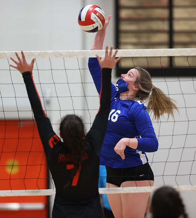 Carson High's Emily Bell rises to attack a ball during the Senator's 3-0 loss to Douglas High in the opening round of the Class 5A Northern Nevada regional postseason.