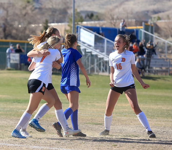Douglas High's Camden Miller (15) yells in excitement after teammates Seara Macpherson (7) scored the opening goal in the Class 5A Northern Nevada regional semifinal against McQueen.