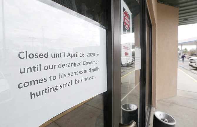 A sign taped the doors at the temporarily closed Lovelock Chevron Casino in early April 2020 protests Governor Steve Sisolak's closure orders.