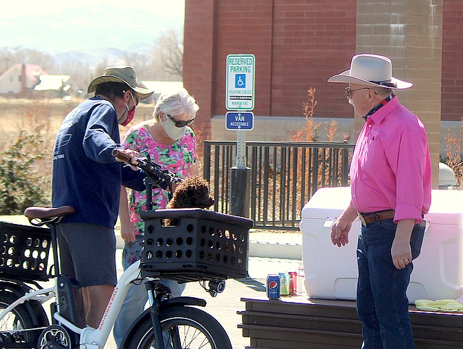 Volunteers and workers provide a drive-through Good Friday luncheon at the Douglas County Senior Center.