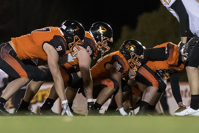 The Douglas High School football team's offensive line gets ready to snap the ball against Galena in the season opener. The Tigers will not take part in a bowl week after a cancellation, meaning head coach Ernie Monfieltto's final result will be a 38-9 win over Carson