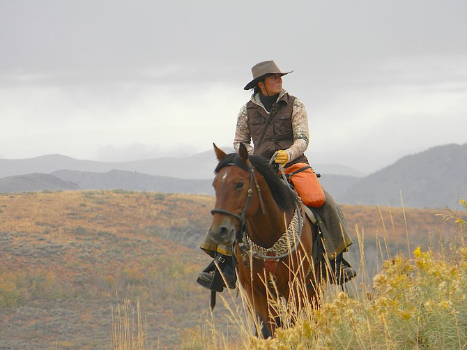 Samantha Szesciorka will begin her third ride across the Silver State on adopted wild horse Sage and dog Juniper on May 1. Photo used with permission.
