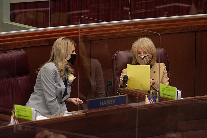 Assemblywomen Melissa Hardy, left, and Heidi Kasama on the first day of the 81st session of the Legislature in Carson City on Monday, Feb. 1, 2021.