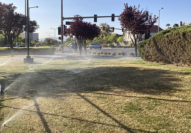 Sprinklers water grass near a street corner April 9 in the Summerlin neighborhood of northwest Las Vegas. (Photo: Ken Ritter/AP)