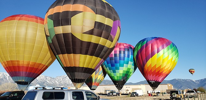 The Sierra Scoop's Lisa Coffron captured a half dozen balloons landing south of Gardnerville on Saturday morning.