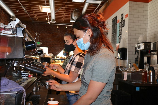 Mickayla Spencer, right, and Mack Peterson prepare drinks at Coffeebar on Mt. Rose Street in Reno on June 17, 2020.