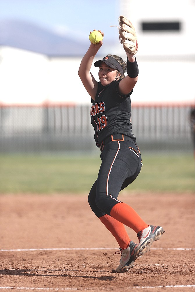 Douglas High pitcher Talia Tretton winds up to throw against Carson High Thursday afternoon. Tretton allowed three hits and one earned run while striking out 10 in a season-opening win over Carson.