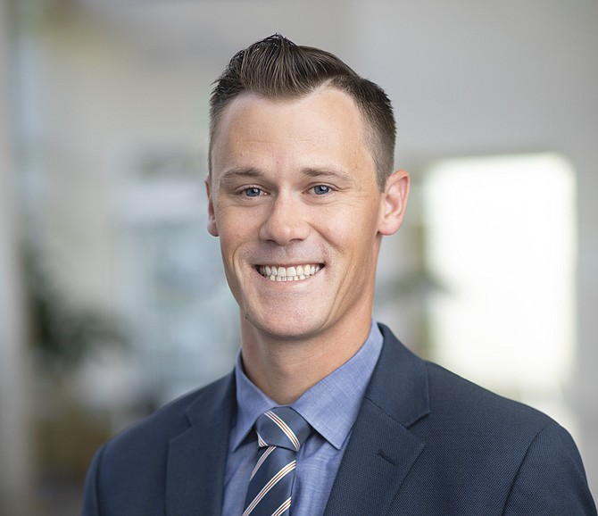 In addition to his full-time role with Renown Health, Chris Nicholas volunteers part of his time as a board member for nonprofit High Fives Foundation.