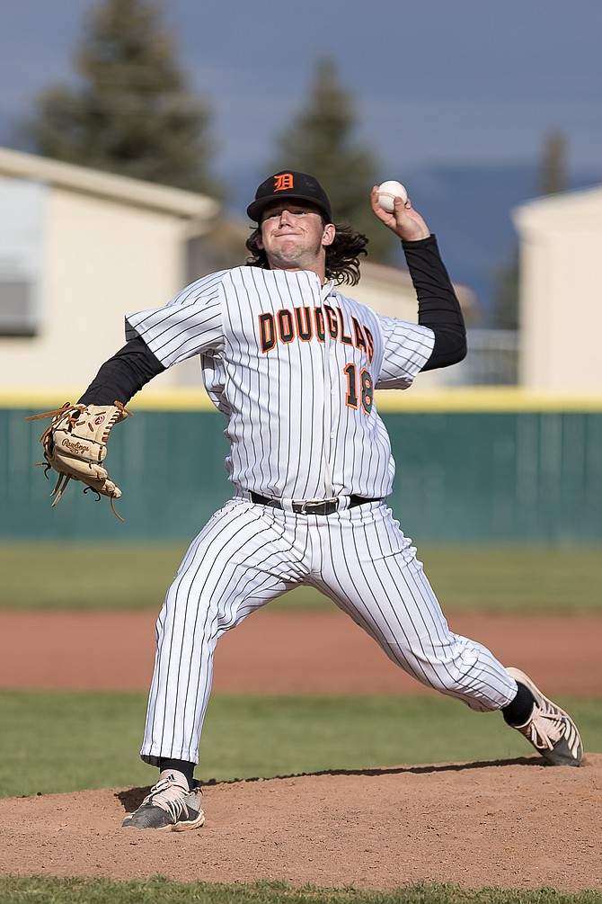 Douglas High senior Matt Goff releases a pitch against Carson High last Thursday. Goff and the eight other Tiger seniors will have a sprint to the finish in a shortened spring season.