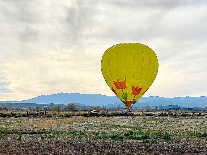 Gardnerville Ranchos resident Terry Burnes took this photo of the Lake Tahoe Balloon landing east of the Pine Nut Road roundabout south of town.