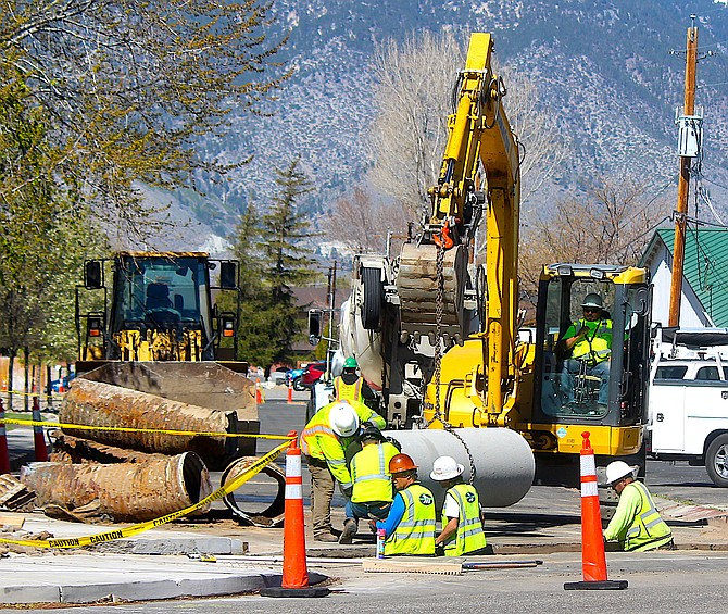 Workers replace the old metal drainage pipe along Cemetery in Gardnerville with new concrete pipe on Wednesday.