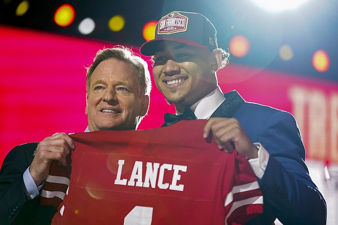 North Dakota State quarterback Trey Lance, right, holds a jersey with NFL Commissioner Roger Goodell after being chosen by the San Francisco 49ers with the third pick in the first round of the NFL draft in Cleveland. (Photo: Tony Dejak/AP)