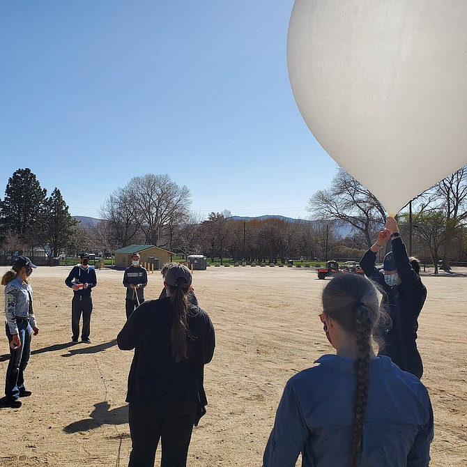 Students prepare to launch a high-altitude balloon at Fuji Park in Carson City.