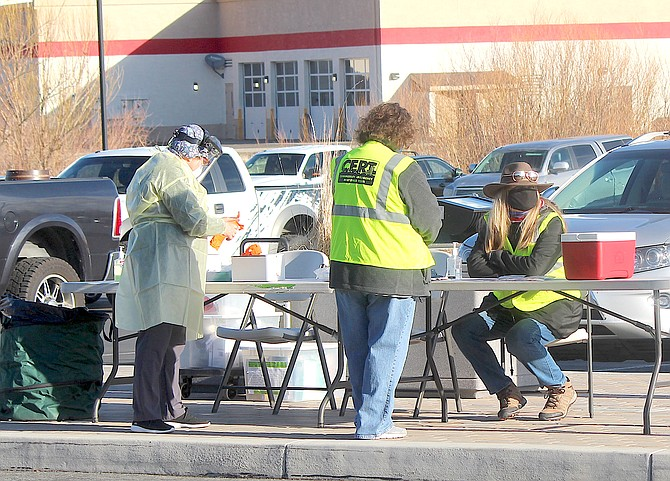 Members of Douglas County's Citizens Emergency Response Team and a health official wait for the first customers at a March 16 coronavirus testing in Gardnerville.