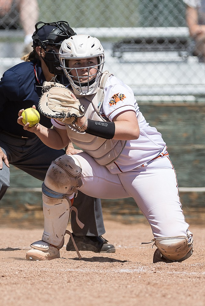 Douglas High catcher Ryleigh Blaire winds up to toss the ball back to the pitcher against Reno on Saturday. Blaire hit her sixth home run of the season Saturday and has now driven in a team-high 18 RBIs on the year.