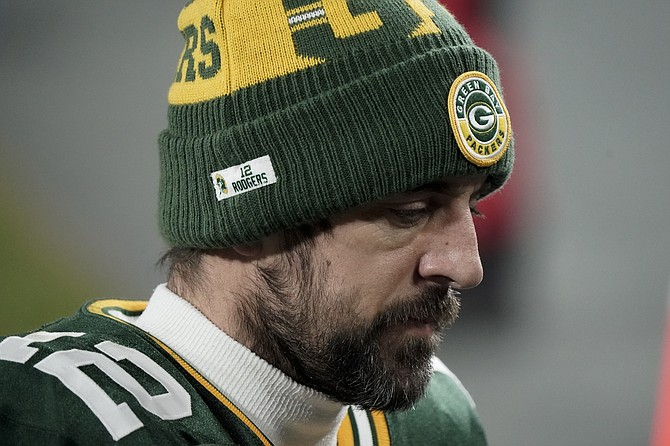 Green Bay's Aaron Rodgers walks off the field after the NFC championship against Tampa Bay in Green Bay, Wis., on Jan. 24. (Morry Gash/AP)