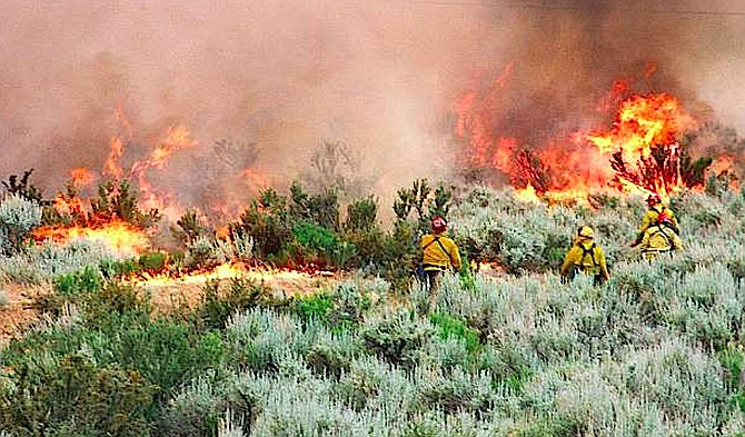 Firefighters face a wall of flames above Foothill Road near Kingsbury Grade in this June 23, 1996, photo taken by Kurt Hildebrand.