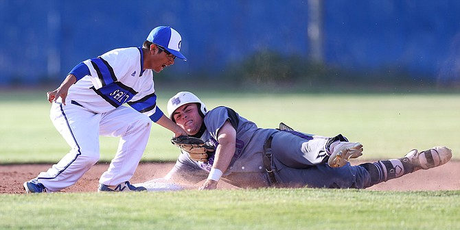 Carson High's Jose Fausto tags Spanish Spring's runner Luke Hutson during the league game between the Carson Senators and the Spanish Springs Cougars at Carson High School.