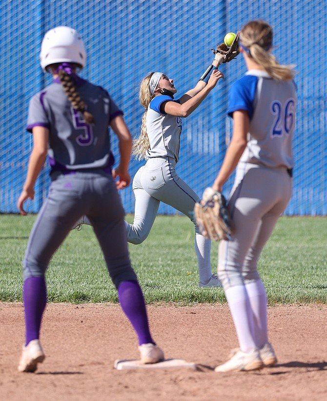 Carson High's Kedre Luschar reaches out to make a catch against Spanish Springs Thursday. Luschar had a triple in the loss to the Cougars.