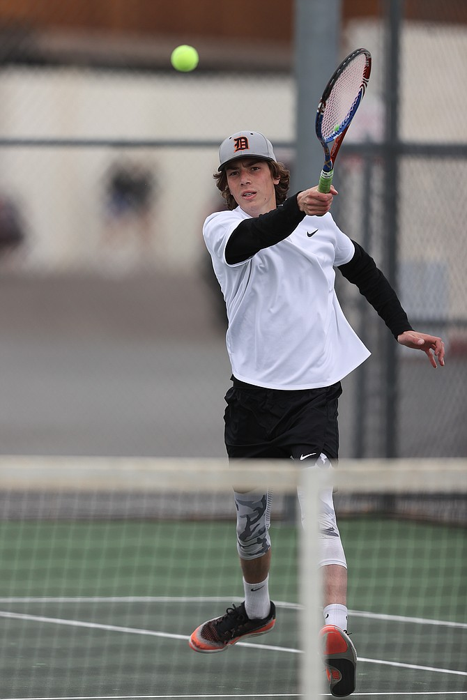Austin Sullivan hits a forehand return shot earlier this season. Sullivan and his doubles partner, Tyler Gunderson, both received second team all-region recognition for their play this spring.