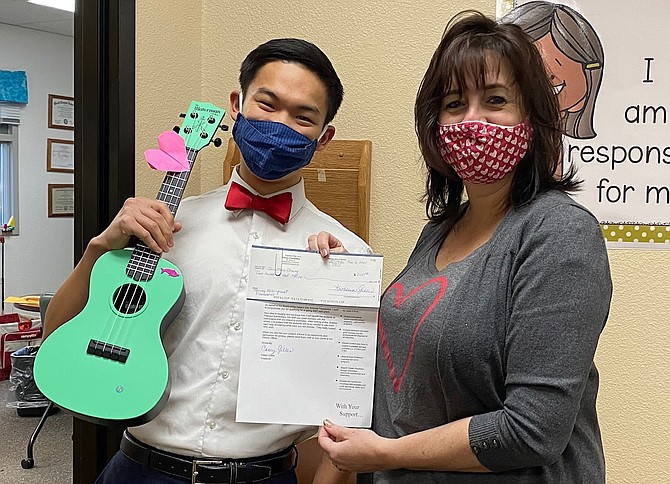 Fremont Elementary School music teacher Jonathan Chang celebrates mini grant funds for new instruments with Principal Jen Ward-DeJoseph.