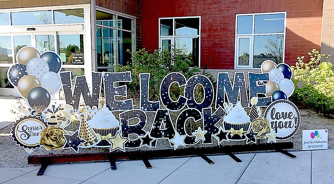 A sign welcomes seniors back to the Douglas County Senior Center on Monday morning.