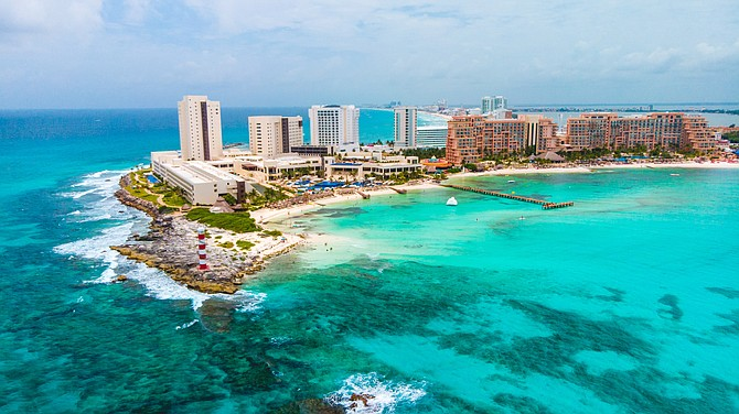 Aerial view of Punta Norte beach in Cancun, Mexico. Kelly Hyatt, a travel consultant for Welcome Aboard Travel in Reno, said she recently booked a $13,000 trip for six people to Cancun.