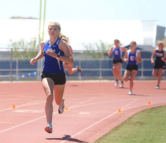 Carson High junior McKenna Budd runs without anyone behind her in the 800-meter run Saturday afternoon at Carson High.