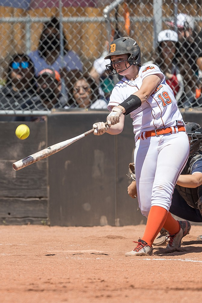 Douglas High freshman Talia Tretton turns on a ball during a contest against McQueen earlier this season. Tretton is hitting .400 in her first varsity season with the Tigers with two home runs, five doubles and 13 RBIs.