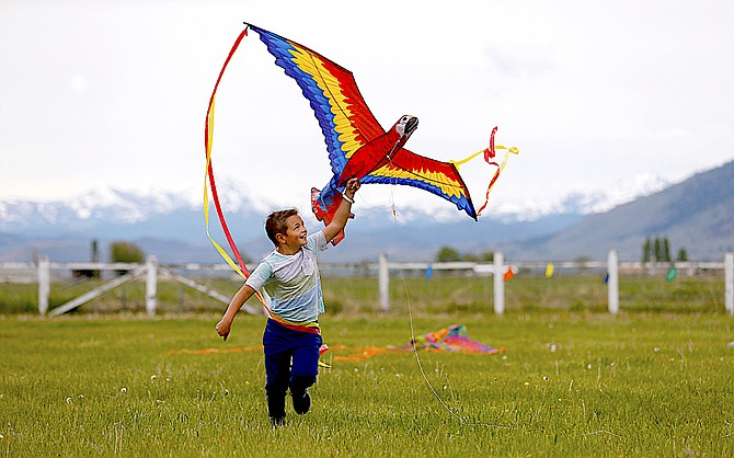 A participant in a 2019 kite flying at the Dangberg Home Ranch.