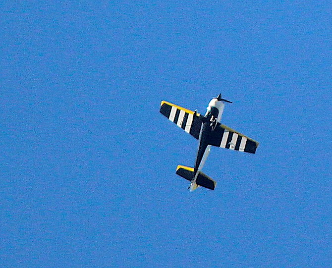 One of two sport planes conducting acrobatics over Genoa on Thursday evening.