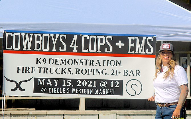 Bailey Schlag just finished tying upm the Cowboys 4 Cops + EMS banner on Friday morning in downtown Gardnerville.